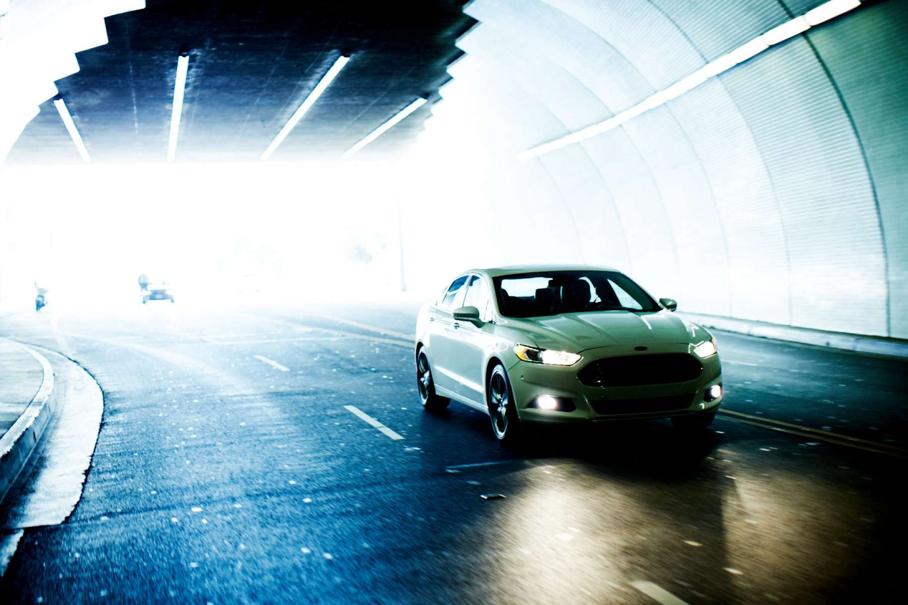 51f6861106bd8_Christian_Kozowyk_car_in_lit_tunnel