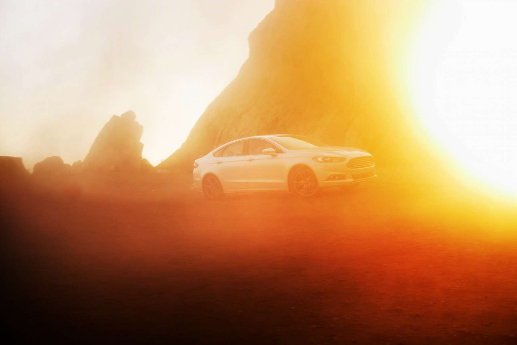 51f68674682c6_Christian_Kozowyk_white_car_sunset_flare